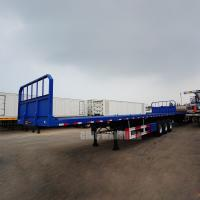 China Heavy duty cargo trailer manufacturers 20 foot 40 foot front wall flatbed semi trailer tri axle flatbed trailer for sale wholesale