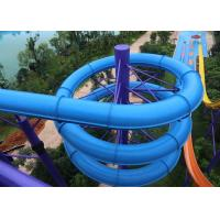 Blue Fiber Glass Closed Spiral Tube Slide In An Amusement Park Water Slide