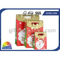 China Customized Christmas Gift Packaging Bag with Die Cut Handles Ribbon Bowknot on sale